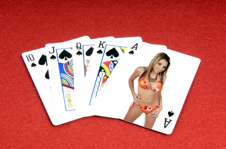 One of the highest hands in poker a Spades Royal Flush on a red